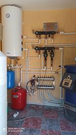 Установка котла Казак с современной системой отопления