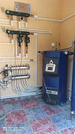 Монтаж системы отопления с котлом Казак